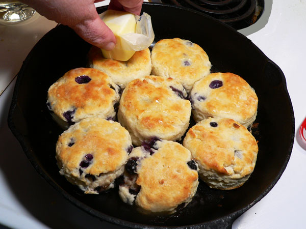 Blueberry Biscuits, butter the tops.